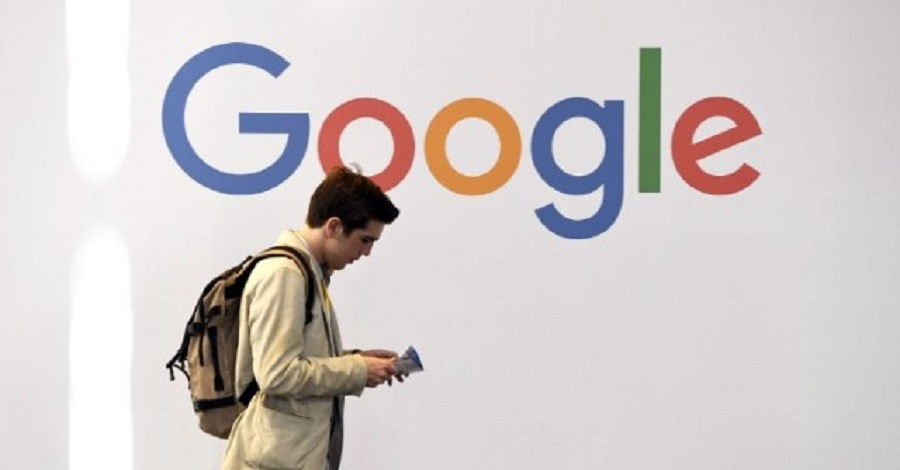 """(FILES) In this file photo taken on May 24, 2018 A man walks past the logo of the US multinational technology company Google during the VivaTech trade fair ( Viva Technology), in Paris. Google on Monday, October 1, 2018, announced that it will test a video game streaming platform with the release of """"Assassin's Creed Odyssey"""" by Ubisoft this week. Google is collaborating with the French video game colossus to use a new instalment in the hit """"Assassin's Creed"""" franchise to test the ability of Project Stream technology to provide the kind of quick, seamless play powered by in-home consoles as an online service.  / AFP PHOTO / ALAIN JOCARD"""